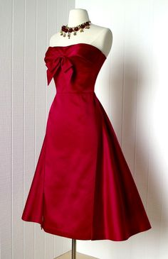 Red satin 1950s dress with bow at neckline