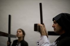 "Penitents from ""Santa Genoveva"" (Saint Guinevere) brotherhood hold their crosses as they wait to take part in a procession in Seville, Spain, Monday, March 25, Semana Santa 2013. Hundreds of processions take place throughout Spain during the Easter Holy Week. (AP Photo/Emilio Morenatti)"