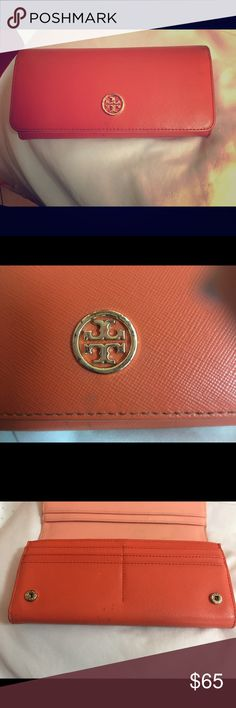 Used real Tory Burch orange wallet The wallet is used. The Tory Burch sign on the sign on the outside of the wallet is Rusted and scratched. Tory Burch Bags Wallets