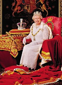 With her 18ft Robe of State draped around her and wearing the Diamond Diadem we see on stamps, the Queen sits in the Throne Room at Buckingham Palace