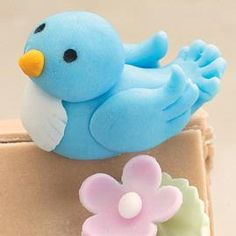 Use this Fondant Blue Bird to symbolize happiness at a shower or birthday celebration. Details like notched feathers and a cone beak make him soar! #diy #crafts #wedding www.BlueRainbowDesign.com