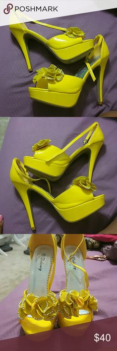 Yellow heels Pretty tall yellow platform heels with flowers on front. Think ankle strap. Worn once. To big Shoes