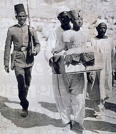 The Mannequin or Bust of Tutankhamun Being Carried from the Tomb Valley of the Kings 1922     www.egyholiday.com