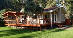 A double wide mobile home's spacious porch and deck addition. via Mobile Home Living
