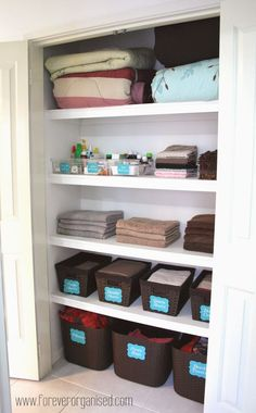 Too many towels, sheets and pillows? Use chic containers and baskets to keep your linen closet looking neat and organized.