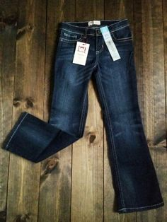 NWT. Lei boot cut jeans. Designer stitching on back pockets. Girl's size 10.  $9. Cut Jeans, Stitching, Garage, Size 10, Pockets, Pants, Design, Fashion, Costura