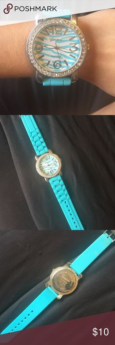 Teal/mint Geneva platinum watch Teal/mint Geneva platinum watch. Well worn, there is some paint on the inside of the wrist band. Also there isn't anything to hold down excess band so it's too big for me. Accessories Watches