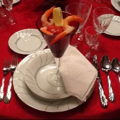 Close up on the china, flatware and crystal place setting. Nothing perfect, just simple and nice. February 2012.
