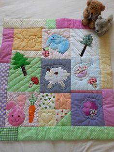 copertina per bambini in patchwork con applique degli animali