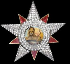 A rare and early silver and enamel Insignia of the Qajar Order of the Lion and Sun probably Russia, circa 1820