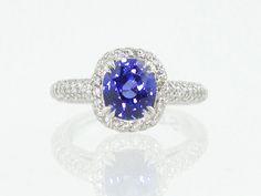 Vivid blue sapphire in a pave diamond halo setting by Renaissance Platinum.  Union Street Goldsmith, San Francisco.