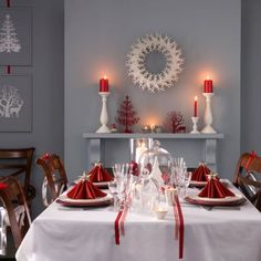 Budget-busting Christmas dining room -   Instead of a runner, use long lengths of ribbon to give a white tablecloth a festive touch  Paint a picture frame (without the glass) and stick a silhouette decoration to it  dining chairs with personalised letters tied with red ribbon