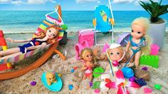 Anna and Elsa Toddlers Play in the Sand and Swim at the Beach with Barbi...