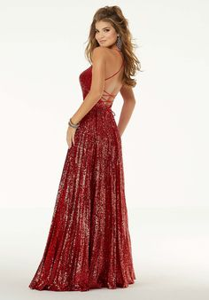 Shop Morilee's Sequined A-Line Prom Dress. Sparkling sequined gown with a pleated skirt and thigh-high slit. This dress features and deep-v neckline and revealing crisscross back. Designer Prom Dresses, A Line Prom Dresses, Formal Dresses For Women, Gown With Slit, Sequin Formal Dress, Prom Dress Stores, Mori Lee, Evening Gowns, Fashion Dresses