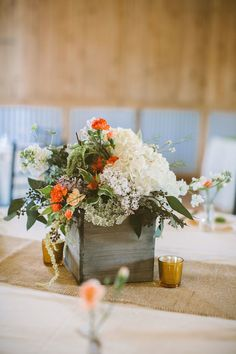 boxed centerpieces, photo by Hot Metal Studio http://ruffledblog.com/white-barn-wedding #flowers #weddingcenterpieces