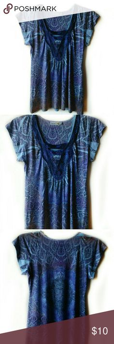 """Unity World Wear Short Sleeve Tunic Blues, lilac, purples.  Size Large.   Chest is 18"""".  Length is 26"""".  Measurements are approximate and in flat position.   94% Polyester, 6% Spandex.   Has stretch. Unity World Wear Tops Tunics"""