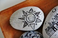 """sun"" ~ pebbles from Portugal, hand painted by Sabine Ostermann"
