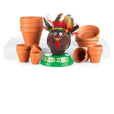 Thanksgiving Clay Pot Turkey    This festive Thanksgiving turkey is a great way to bring some holiday cheer into your home. A fun project the entire family can get involved with, you'll love the finished project!