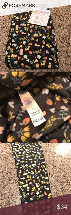LuLaRoe OS leggings. Flowers and mushrooms! New. With tag. In package. LuLaRoe one size leggings. Second picture shows true gray color. Gray background. Flowers. Mushrooms. LuLaRoe Pants Leggings