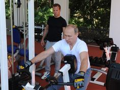 PHOTO: Russian President Vladimir Putin and Prime Minister Dmitry Medvedev work out at a gym at the Bocharov Ruchei state residence in Sochi on Aug. 30, 2015.