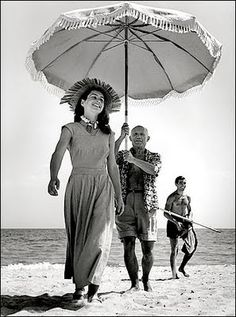françoise gilot with picasso & nephew javier vilato on the beach at golfe-juan, france by robert capa, 1948