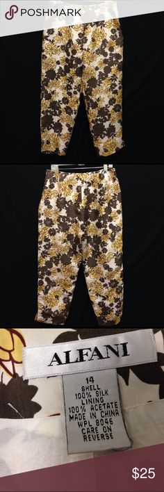 Alfani Silk Floral Design Cropped Pants Waist 33 Front Rise 12 Back Rise 13.5 Inseam 27. These pants are in excellent condition. They have no stretch as they are made purely of silk. There is an inner lining to the pant. These are cropped so they fit a little longer than a Capri but not quite to the ankle. Alfani Pants Ankle & Cropped