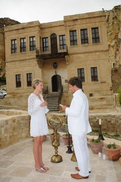 Adorable couple exchanging vows during ceremony