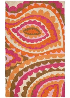 Dress your home in the vibrant, spirited designs of fashion icon Trina Turk with the Vivacious rug. Feminine and flirty scalloped lines form an overscale paisley graphic in popping pinks and zesty oranges for a fresh burst of color on the floor. Pairing handcrafted quality and style savvy design; any kitchen, bathroom or living space achieves vintage chic with this hooked wool rug in the mix. Rug measures 3' x 5' 100% Wool with cotton canvas backing Rug pad recommended