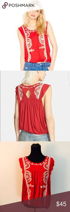 {Free People} Dos Segundos Embroidered Top This beautiful free People top is a gorgeous bright red color and has detailed embroidery all over. Very soft and comfortable. Hem has elastic waistband in it. Big open arm holes. No noticeable flaws. Size large.   MEASUREMENTS & MATERIAL:  Bust; 13.5 inches across  Shirt length: 22.5 inches  100% viscose  Feel free to ask for a specific measurement! Free People Tops