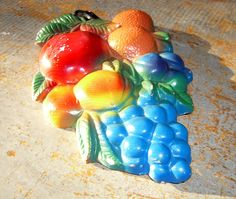 $7.50 Vintage Wall Decor, Apple, Oranges, Peaches and Grapes, Plaster Fruit Cluster,. $7.50, via Etsy.