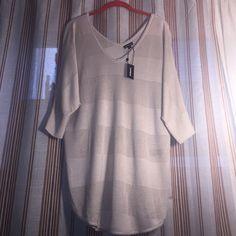 ❤️ NWT Stylish Tunic❤️ ❤️ NWT So pretty stylish great fabric long tunic by Express, Size L ❤️ Express Tops Tunics