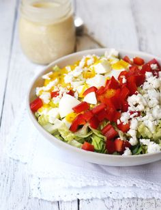 Vegetarian Cobb Salad - made with romaine lettuce, hard boiled eggs, raw goat feta, cherry tomatoes, bell pepper, green onion, and honey dijon dressing