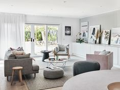 The norsuHOME - Living Room Photographer: Lisa Cohen Stylist: Beck Simon  Paint: Dulux Tranquil Retreat Cabinetry: kaboodle Kitchens Flooring: Godfrey Hirst  Panelling: EasyCraft  Products: GlobeWest Livorno Dining table, Vittoria Mia Sofa, Gus Margot chair, Ingrid Chair, Como Coffee table & Livorno side table, Love Warriors Sky Circles print, Donna Delaney Matilda Print, Middle of Nowhere prints, Armadillo & Co Sherpa rug (all available at www.norsu.com.au)