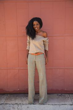 love everything about this, wide leg pants, netural off the shoulder top and I would do a lot for that hair!