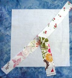 Photo of string quilt block with two fabric strips added