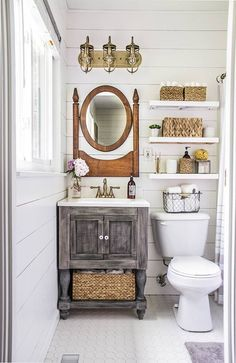 White wood paneled walls instill a rustic feel to this country-inspired bathroom.