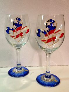 Hand painted wine glasses dishwasher safe. $50.00, via Etsy.
