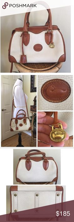 """VINTAGE DOONEY AND BOURKE SM GLADSTONE Vintage D&B Small Gladstone in Bone w/British Tan Trim.  This is a pre-tag bag.  The attached duck fob is not the original fob.  This bag is in good condition.  Piping, trim & handles do show darkening and wear.  Comes with shoulder strap, lock & keys.  Interior is clean no rips or tears.  2 interior pockets on each side (2 slip pockets on 1, 1 zip pocket 1 slip pocket on 2nd) 🔵SEE ALL PICTURES🔵 ALL MEASUREMENTS ARE APPROXIMATE: 11.0"""" L X 7.25"""" H X…"""