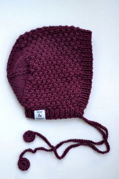 knitted baby bonnet, love the color and the stitch pattern