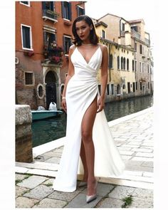 Bella Hadid dressed to impress in a classy white high slit maxi with satin heels. #bellahadid #modelstyle #bigstyler #datenightstyle #classystyle #getthelook #shopthelook #ootd #mylook #currentlywearing #lookoftheday #wearitloveit #todaysdetails #DateNight #NYFW #WeekendLook #BeachVacation