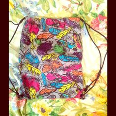 Feather pull string bag with pocket Cute never used! Bags