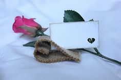 Heart shaped burlap / hessian place card holder - what a novel idea for a rustic wedding theme.