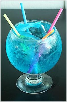 Blue Shark Drink Recipe    12 or more blue gummy sharks 24 or more ice cubes 12 oz. can lemonade concentrate 12 oz. cranberry juice cocktail 1 liter bottle tonic water Dash of grenadine 2 liter bottle Seven-Up 2 shots gin 3 shots white rum 3 shots vodka The longest straws you can find (one for each person) Punch bowl or other lg. shallow bowl