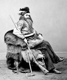 "Seth Kinman (died 1888) in 1865 in a chair he presented to President Andrew Johnson. Aside from a famous chair maker and grizzly hunter, ""he was also a hotel keeper, barkeeper, and a musician who performed for President Lincoln on a fiddle made from the skull of a mule."" Hell. Yes."