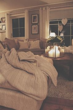 Cozy. Love the candles set in a case case, layers of pillows, and texture of the rug and throw.