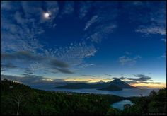 Dark Sun over Ternate March 10 2016 via NASA A dark Sun hangs in the clearing sky over a volcanic planet in this morning sea and skycape. It was taken during this week's total solar eclipse a dramatic snapshot from along the narrow path of totality in the dark shadow of a New Moon. Earth's Indonesian isle of Ternate North Maluku lies in the foreground. The sky is still bright near the eastern horizon though beyond the region's flattened volcanic peaks and outside the Moon's umbral shadow. In…