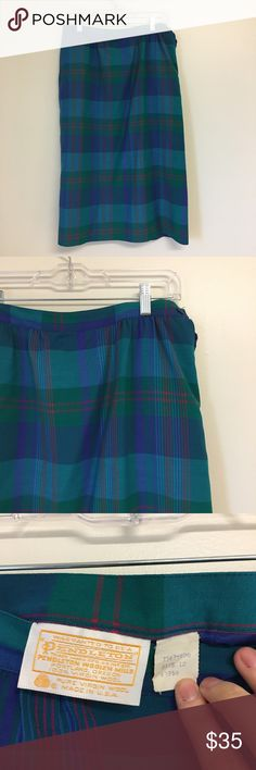 "Vintage 70's Pendleton Plaid Midi Skirt Beautiful Plaid ""Pendleton"" brand midi-skirt. Has pockets, size button closure. Fully lined. Tag says: ""Warranted to be Pendleton. Trademark REG. US. Pat. Off. Pendleton Woolen Mills. Portland, Oregon. 100% Virgin Wool. Pure Virgin Wool, Made in the USA."" 31"" inch waist, 29"" length. Vintage Skirts Midi"