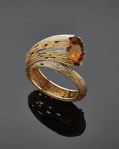 A gold textured wire, citrine and diamond bangle by Andrew Grima   grimaarchives 0a6d2ab2dac2