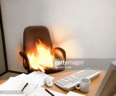 Office Chair On Fire Behind Desk In Cubicle Stock Photo | Getty Images