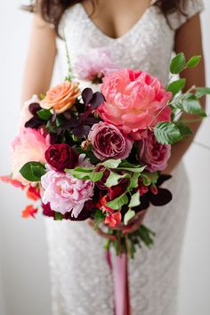 Pink and purple bouquet with peonies and roses | Jerome Cole Photography | See more: http://theweddingplaybook.com/20-beautiful-wedding-bouquets-to-have-and-to-hold/
